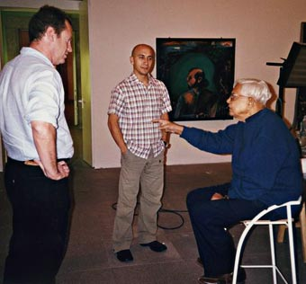 Bhupen consulting with Enrique Juncosa, curator of the retrospective at the Museo Nacional Centro de Arte Reina Sofia, and his assistant, Madrid, 2002