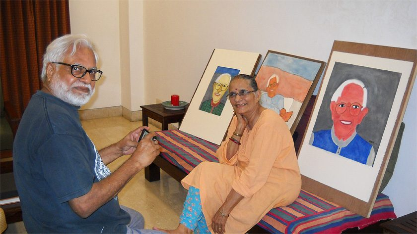 "Manu and Madhvi Parekh with Madhvi's portraits of Bhupen, ""Our Friend Bhupen,"" acrylic on paper,  September 2014.  They were close friends of Bhupen, and he often stayed with them in Delhi."